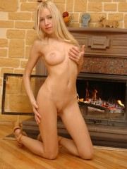 Stripping Down Naked Next To The Fireplace - Picture 14